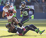 Seattle Seahawks defensive back Kam Chancellor (31) takes down Tampa Bay Buccaneers running back Brian Leonard (30)in the quarter at CenturyLink Field in Seattle, Washington on  November 3, 2013.  The Seahawks beat the Buccaneers 27-24 in overtime. ©2013. Jim Bryant. All Rights Reserved.