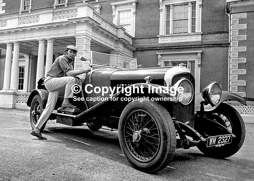 Henry Mulholland, 4th Lord Dunleath, Ballywalter, Co Down, N Ireland, at the wheel of an open-top Bentley in front of Ballywalter Park Mansion House. 197507000569c.<br />
