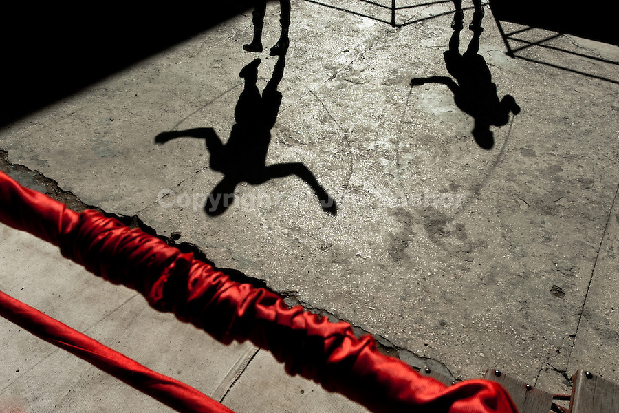 Young Cuban boxers jump rope during a drill at Rafael Trejo boxing gym in Havana, Cuba, 5 February 2010. During the last 30 years Cuba has produced more World Champions and Olympic gold medallists in amateur boxing than any other country. Many famous fighters, who came out of Cuba, were training at Rafael Trejo boxing gym in their youth. This run down open air facility in the Old Havana is a place of learning and mastering the art of boxing by the old school style. Boys begin their training very young. As sports are given a high political priority in Cuba, all children are systematically encouraged to develop their skills. Those who succeed will become heroes of Cuban society.
