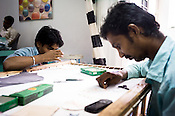 Artists are seen embroidering designs on fabric at Sophie 203 workshop in Jaipur, Rajasthan, India.