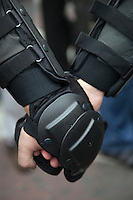 Moscow, Russia, 31/08/2010..Riot police hold hands as police break up an opposition protest in central Moscow and arrest around 70 people. Opposition activists hold regular demonstrations on the 31st day of the month, protesting against restrictions on the freedom of assembly, which is protected by article number 31 of the Russian constitution.
