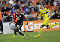 WASHINGTON, DC - OCTOBER 20, 2012:  Lionard Pajoy (26) of D.C United races for the ball with Josh Williams (3) of the Columbus Crew during an MLS match at RFK Stadium in Washington D.C. on October 20. D.C United won 3-2.