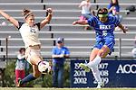 27 October 2013: Duke's Laura Weinberg (16) shoots past Pittsburgh's Morgan Sharick (25). The Duke University Blue Devils hosted the Pittsburgh University Panthers at Koskinen Stadium in Durham, NC in a 2013 NCAA Division I Women's Soccer match. Duke won the game 6-3.