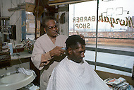 December 1976. Americus, Georgia. Black barber shop in Americus.