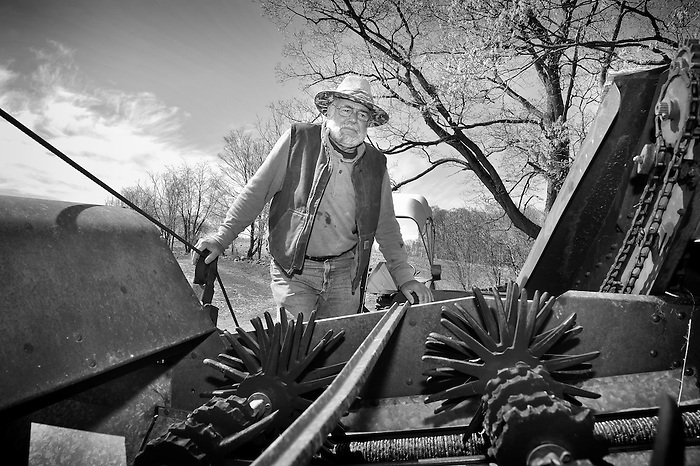 A farmer in New York State looking over a tractor