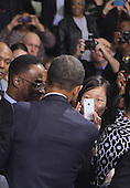 United States President Barack Obama shakes hands after making a statement on the economy at James Lee Community Center in Falls Church, Virginia on Wednesday, February 1, 2012..Credit: Dennis Brack / Pool via CNP