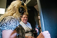 Lorton,VA, July 10 2016, USA--Rita Mayer (right) shows Melissa Vesperman, her AK 15 pistol, at a gun range in Lorton, VA.  Mayer and Vesperman are both transgender woman and are members of Pink Pistols. Members of the Pink Pistols, a Lesbian,Gay, Bi-sexual, Transgender (LGBT) gun club, gather at a shooting range to practice their skills.  The Pink Pistols advocate the rights of all LGBT people to own guns.  Patsy Lynch/MediaPunch