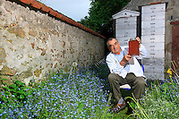 "Jean Paucton, at his home in Coignières in the Yvelines. ""I sometimes harvest over 100 kilos of honey per hive in Paris for less than 20 in Coignières or in the Creuse. I presently have five hives on the opera. I harvest little by little, frame by frame, the passage to get on to the roof is narrow. As a rule, I go on Sundays""."
