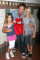Rande Gerber & his children at the LA Mission Thanksgivng Feeding of the Homeless in    Los Angeles, CA.November 26, 2008.©2008 Kathy Hutchins / Hutchins Photo....