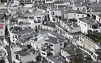 Rooftop view, Pampaneira, in the gorge of the Poqueira river, Alpujarra, Andalucia, Southern Spain. Moorish influence is seen in the distinctive cubic architecture of the Sierra Nevada's Alpujarra region, reminiscent of Berber architecture in Morocco's Atlas Mountains. Photograph by Manuel Cohen.