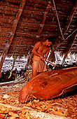 EDITORIAL ONLY. Demonstration of canoe carving and building at Pu'uhonua o Honaunau National Park, South Kona, Big Island