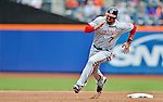 11 April 2012: Washington Nationals infielder Mark DeRosa rounds second and heads for third during action against the New York Mets at Citi Field in Flushing, New York. The Nationals shut out the Mets 4-0 to take the rubber match of their 3-game series. Mandatory Credit: Ed Wolfstein Photo
