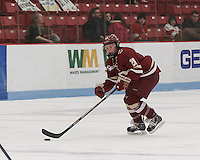 Boston, Massachusetts - February 21, 2015: NCAA Division I. After overtime, Boston University (white/red) tied Boston College (maroon), 2-2, at Walter Brown Arena.