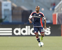 New England Revolution defender Jose Goncalves (23) brings the ball forward.  In a Major League Soccer (MLS) match, the New England Revolution (blue) tied D.C. United (white), 0-0, at Gillette Stadium on June 8, 2013.