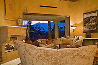 Mediterranean decore living room with fire place sliding glass doors open to outside