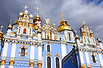Saint Michael's sky-blue beautiful christian cathedral with golden domes in Kiev Ukraine Eastern Europe under dramatic cloudy sky