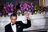 United States President Barack Obama makes a toast after speaking in the State Dining Room of the White House February 26, 2012 in Washington, DC.  President Obama and first lady Michelle Obama hosted 2012 Governors Dinner which coincides with the yearly meeting of the National Governors Association meeting in DC.  .Credit: Brendan Smialowski / Pool via CNP