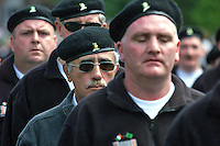 Brendan Hughes, second from front in dark glasses, beret, and with moustache, marches with D Company IRA in a parade on the Falls Rd, Belfast, N Ireland, on 24th June 2001. 20010624001BH..Copyright Image from Victor Patterson, 54 Dorchester Park, Belfast, United Kingdom, UK...For my Terms and Conditions of Use go to http://www.victorpatterson.com/Victor_Patterson/Terms_%26_Conditions.html