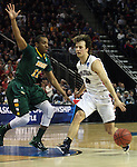 Gonzaga's Kevin Pangos (4) drives to the basket past North Dakota State's Lawrence Alexander (12) during the 2015 NCAA Division I Men's Basketball Championship's March 20, 2015 at the Key Arena in Seattle, Washington.   ©2015. Jim Bryant Photo. ALL RIGHTS RESERVED.