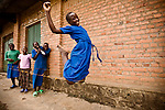 Young girls jump rope between classes outside the village school housein the genocide survivors village of Rugerero Rwanda.