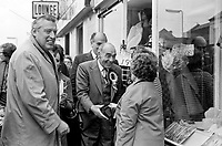 Johnny McQuade, UUUC canditate canvassing Shankill Road, Belfast, N Ireland, with support from Rev Ian Paisley and Harry West, leader, Ulster Unionist Party. The electioneering was for the UK General Election on the 10th of October. McQuade and West were unsuccessful. 197410090526f  <br />