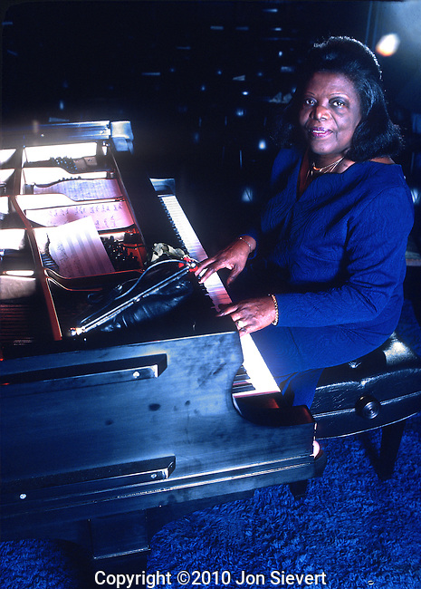 Mary Lou Williams, Keystone Korner, San Francisco, May 1977. American jazz pianist, composer, and arranger. Williams wrote hundreds of compositions and arrangements, and recorded more than one hundred records (in 78, 45, and LP versions). Williams wrote and arranged for such famed bandleaders as Duke Ellington and Benny Goodman, and she was friend, mentor, and teacher to Thelonious Monk, Charlie Parker, and Dizzy Gillespie.