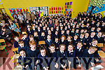 Caherleaheen NS pupils say goodbye to retiring Teachers Donal and Mavee O'Connor at the  Grandparents Day mass on Friday