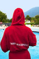 Switzerland. Canton Ticino. Tenero. Centro Sportivo Nazionale della Gioventù - Tenero (CST). Nationales Jugendsportzentrum Tenero. A member of the swiss woman water polo team outside the swimming pool.  31.05.11 © 2011 Didier Ruef