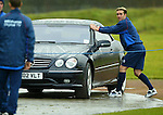 Prankster Fernando Ricksen trying to set off David Murray's car alarm at training