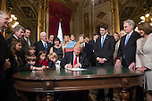 United States President Donald Trump is joined by the Congressional leadership and his family as he formally signs his cabinet nominations into law, Friday, Jan. 20, 2107, in the President's Room of the Senate on Capitol Hill in Washington From left are, US Senate Majority Leader Mitch McConnell (Republican of Kentucky), US Senator Roy Blunt (Republican of Missouri), Donald Trump Jr., US Vice President Mike Pence, Jared Kushner, Karen Pence, Ivanka Trump, Melania Trump, Barron Trump, Speaker of the US House Paul Ryan (Republican of Wisconsin), US House Majority Leader Kevin McCarthy (Republican of California), US House Minority Leader Nancy Pelosi (Democrat of California).<br /> Credit: J. Scott Applewhite / Pool via CNP