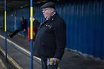 City of Liverpool 6 Holker Old Boys 1, 10/12/2016. Delta Taxis Stadium, North West Counties League Division One. A home supporter watching the first-half action at the Delta Taxis Stadium, Bootle, Merseyside as City of Liverpool hosted Holker Old Boys in a North West Counties League division one match. Founded in 2015, and aiming to be the premier non-League club in Liverpool, City were admitted to the League at the start of the 2016-17 season and were using Bootle FC's ground for home matches. A 6-1 victory over their visitors took 'the Purps' to the top of the division, in a match watched by 483 spectators. Photo by Colin McPherson.