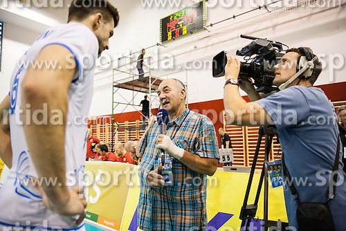 Injured journalist Marjan Fortin interviewing Mitja Gasparini of Slovenia after the friendly volleyball match between National teams of Slovenia and Bulgaria on August 29, 2013 in Hoce, Slovenia. Slovenia defeated Bulgaria 3-1. (Photo by Vid Ponikvar / Sportida.com)