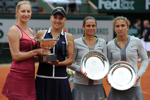 09.06.2013 Paris, France. Elena Vesnina of Russia and Ekaterina Makarova of Russia and Roberta Vinci and Sara Errani hold their trophies after the match in the Women's Doubles Final of the French Open from Roland Garros.