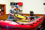 Wolcott, CT- 23 April 2017-042317CM01 Wolcott volunteer firefighter Christian Ciprian holds a rescue sling from the department's Defender hard bottom inflatable boat at the firehouse on Central Ave in Wolcott on Sunday.  The event was part of Volunteer Firefighter Day in Connecticut, with more than 60 fire departments holding open houses at nearly 80 locations throughout Connecticut at the same time on the same day.  Christopher Massa Republican-American