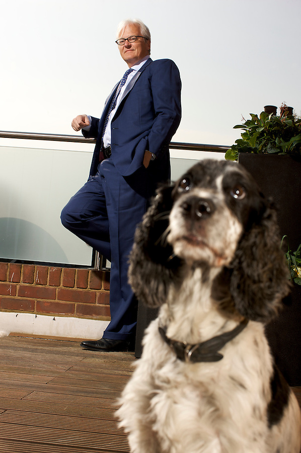 © Martin Beddall/ 2009..Portrait of David Harding, founder, Managing Director and Head of Research at Winton Capital Management Ltd in London UK.  Photographed with his cocker spaniel Cosmo who spends his time in the company office.