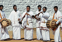 Group of musicians playing traditional instruments at festival in India