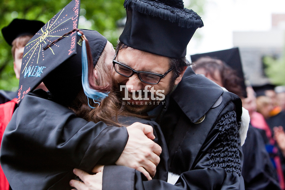 05/22/2011 - Medford/Somerville, Mass. - Biomedical Engineering Professor Fiorenzo Omenetto hugs his student, Valerie Luks, E11, before Phase I of the Tufts University Commencement 2011 ceremonies on the academic quad on May 22, 2011. (Emily Zilm for Tufts University)