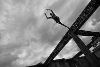 Jose Rodriguez, a freerunner from Plus Parkour team, jumps from the top of the ruined walls during a parkour training session in the outskirts of Bogotá, Colombia, 22 February 2016. Parkour, originally developed in France during the late 1980s from military training, is a physical activity, focused on the art of movement and overcoming obstacles in a strictly urban environment. Practitioners of parkour employ running, climbing, jumping, rolling and other movements to pass through any urban area the most efficient way possible.