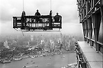 The Peoples Republic of China. Shanghai. 2000. Window cleaners get a lift to the top of the Jin Mao Building in Pudong.  The elevated highway of Yan?an Zhong Lu can be seen snaking down to the Bund, while the dark area to the left is the site of old Chinese city known as Nanshi.