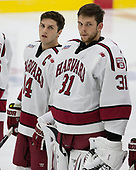 Alexander Kerfoot (Harvard - 14), Merrick Madsen (Harvard - 31) - The Harvard University Crimson defeated the US National Team Development Program's Under-18 team 5-2 on Saturday, October 8, 2016, at the Bright-Landry Hockey Center in Boston, Massachusetts.