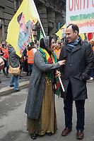 Milano, corteo per chiedere la liberazione del leader del Pkk, Abdullah Ocalan, in carcere dal 1999. Una donna curda parla con il deputato Faysal Sariyildiz.<br /> Milan, march to demand the release of PKK leader Abdullah Ocalan, in prison since 1999. A Kurdish woman speaks with Congressman Faysal Sariyildiz.<br /> Feb 11,2017