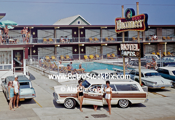 Buccaneer Motel, North Wildwood NJ. Neon sign and old cars. 1960's.