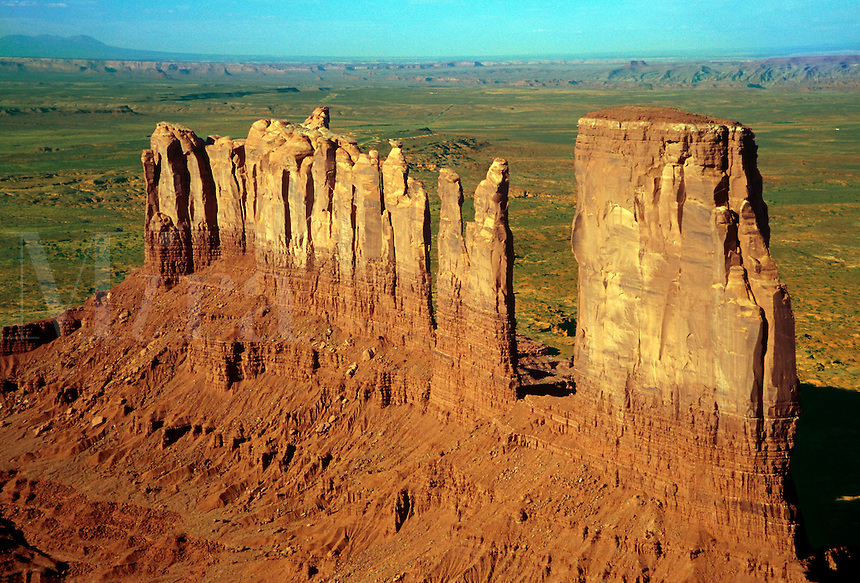 Stone columns and spires are all that remain here of an ancient plateau that was eroded and carried away by water and wind. Monument Valley Navajo Tribal Park, Arizona