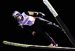 Adam Malysz of Poland soars through the night sky in the the normal hill individual jump event at the Nordic Skiing World Championships in Sapporo, Japan in March, 2007