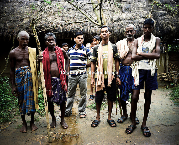 "Raghunath Das (left) and many other villagers take on the responsibility to guard the gate leading to their village Dingkhia in Orissa, India. These villagers have formed an agitating group, ""Posco Pratirdh Sangram Samiti"" to oppose the construction of Posco port in their village."