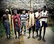 Raghunath Das (left) and many other villagers take on the responsibility to guard the gate leading to their village Dingkhia in Orissa, India. These villagers have formed an agitating group, &quot;Posco Pratirdh Sangram Samiti&quot; to oppose the construction of Posco port in their village.