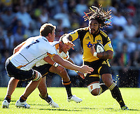 Hurricanes' Ma'a Nonu runs at the Brumbies defence during the Super 14 rugby union match between the Hurricanes and Brumbies at Porirua Park, Wellington, New Zealand on Friday 29 January 2010. Photo: Dave Lintott / lintottphoto.co.nz