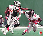 EAST RUTHERFORD, NJ-10/25/98-1025BF02.tif-- The Falcons Jamal Anderson (32) is pulled down in the second half by the Jets Victor Green (21) Sunday at The Meadowlands. BOB FALCETTI PHOTO