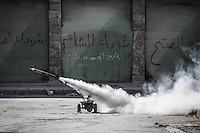 A homemade rocket is launched by rebel fighters belonging to the Al-Fatah Kateba as they carry out militar operations to gain terrain over the Syrian army at Bustan Al-Bashar district in Aleppo City.