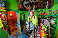 BNPS.co.uk (01202 558833)<br /> Pic: PhilYeomans/BNPS<br /> <br /> Artist Mary Rose Young.<br /> <br /> Britain's wackiest property has come on the market...And the estate agents mantra of paint everything magnolia has definately not been applied.<br /> <br /> It may look like an idyllic cottage in the Forest of Dean from the outside but ceramic artist Mary Rose Young's unique taste has transformed the interior into what looks like something from Alice in Wonderland.<br /> <br /> The three-bedroomed house is decorated from head to toe in crazy colours, clashing patterns, and enormous murals,<br /> each room is covered in the garish designs, including the bathroom, where even the sink and toilet have been adorned in bright tiles.<br /> <br /> Estate agents Bidmead Cook now have the tricky task of showing prospective punters round the &pound;500,000 property.